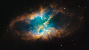 Planetary nebula NGC 2818, which resides within a star cluster in the Milky way, as captured by the Hubble Space Telescope on January 15th, 2009.